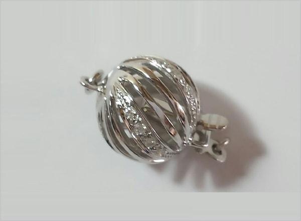 Diamond-set cage clasp